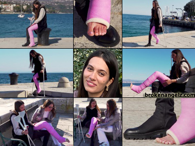 Lara pink LLC - Lara is hanging out on the pier waiting for her friend but its still cool on the Adriatic coast and while she is wearing one knee high boot on her good leg, her exposed toes are sticking out of her completely casted other leg, and ...