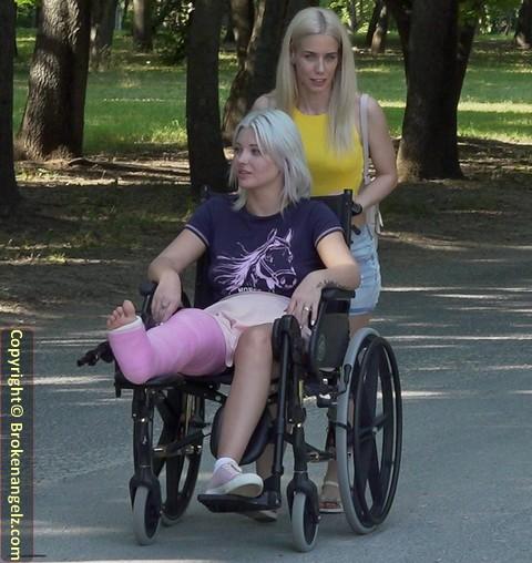 Zazie LLC - Zazie in a pink fibre fullleg cast, in wheelchair and on underarm crutches
