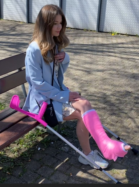 Katia in pink SLWC on crutches...