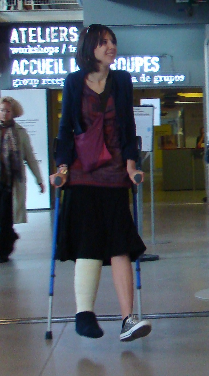 Woman with cast and crutches