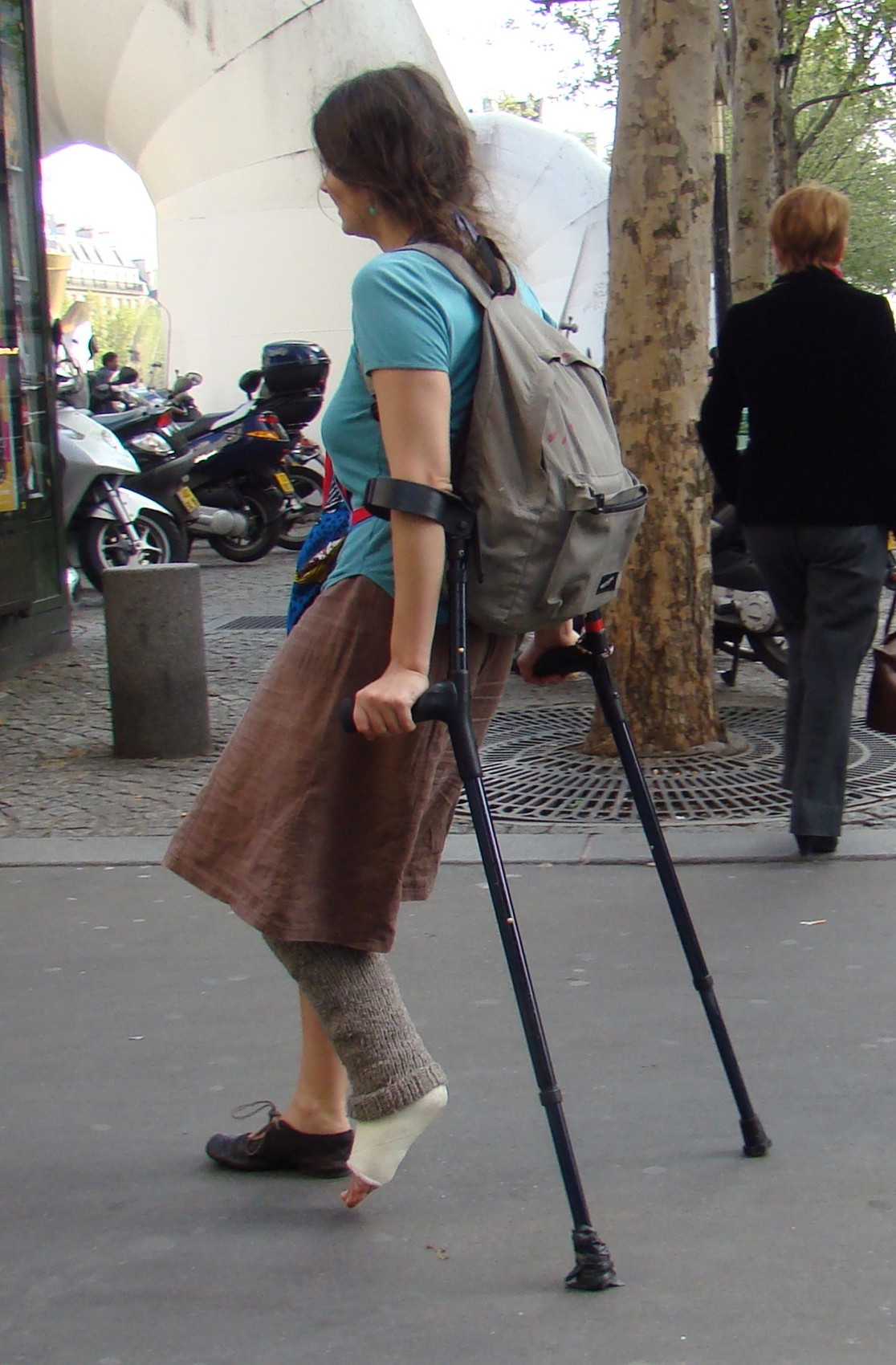 Woman with cast, fluffy sock and crutches (Pix & Video)