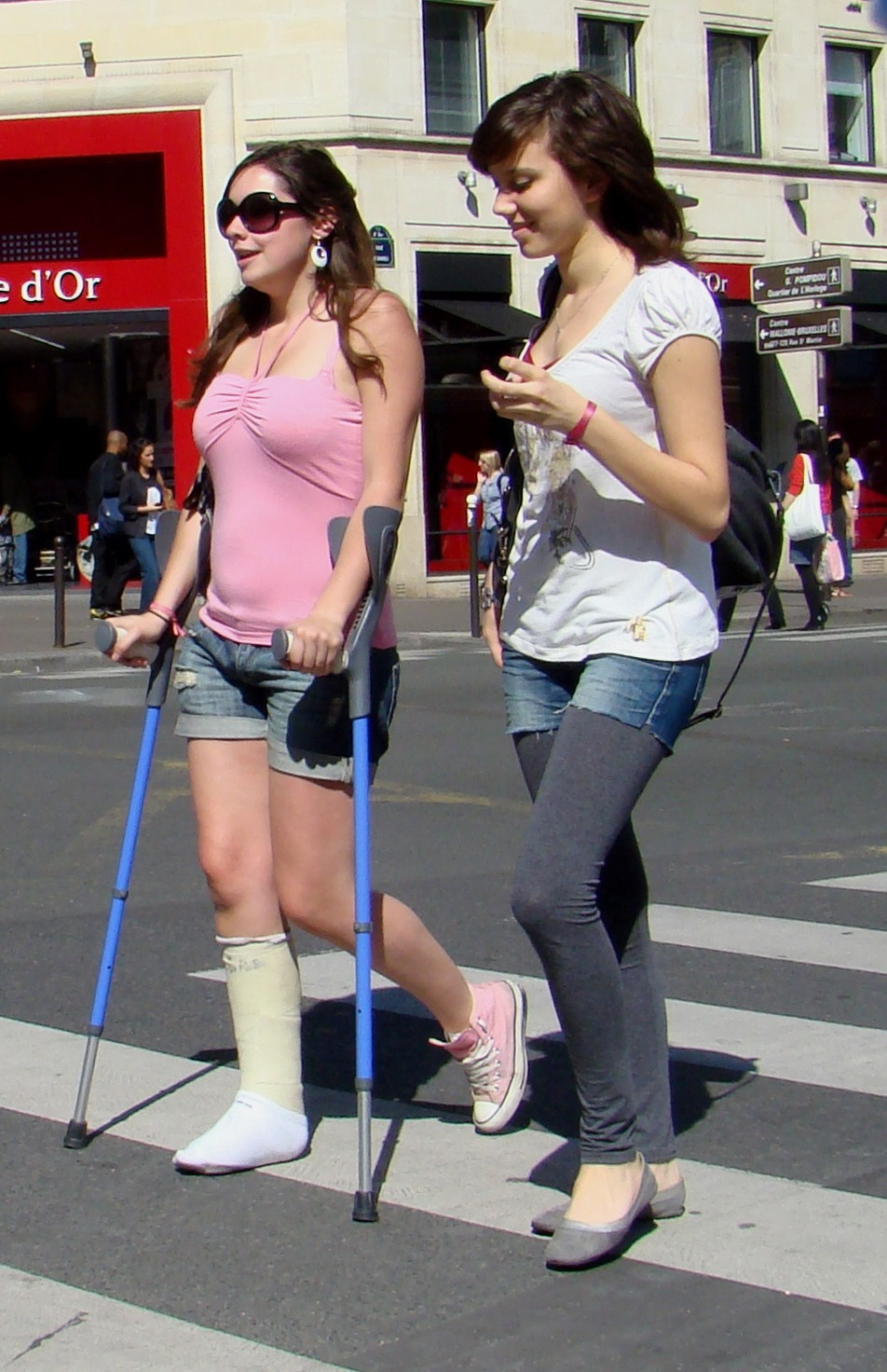 Woman with worn cast, crutching in the sunshine.. (Pix & Video)