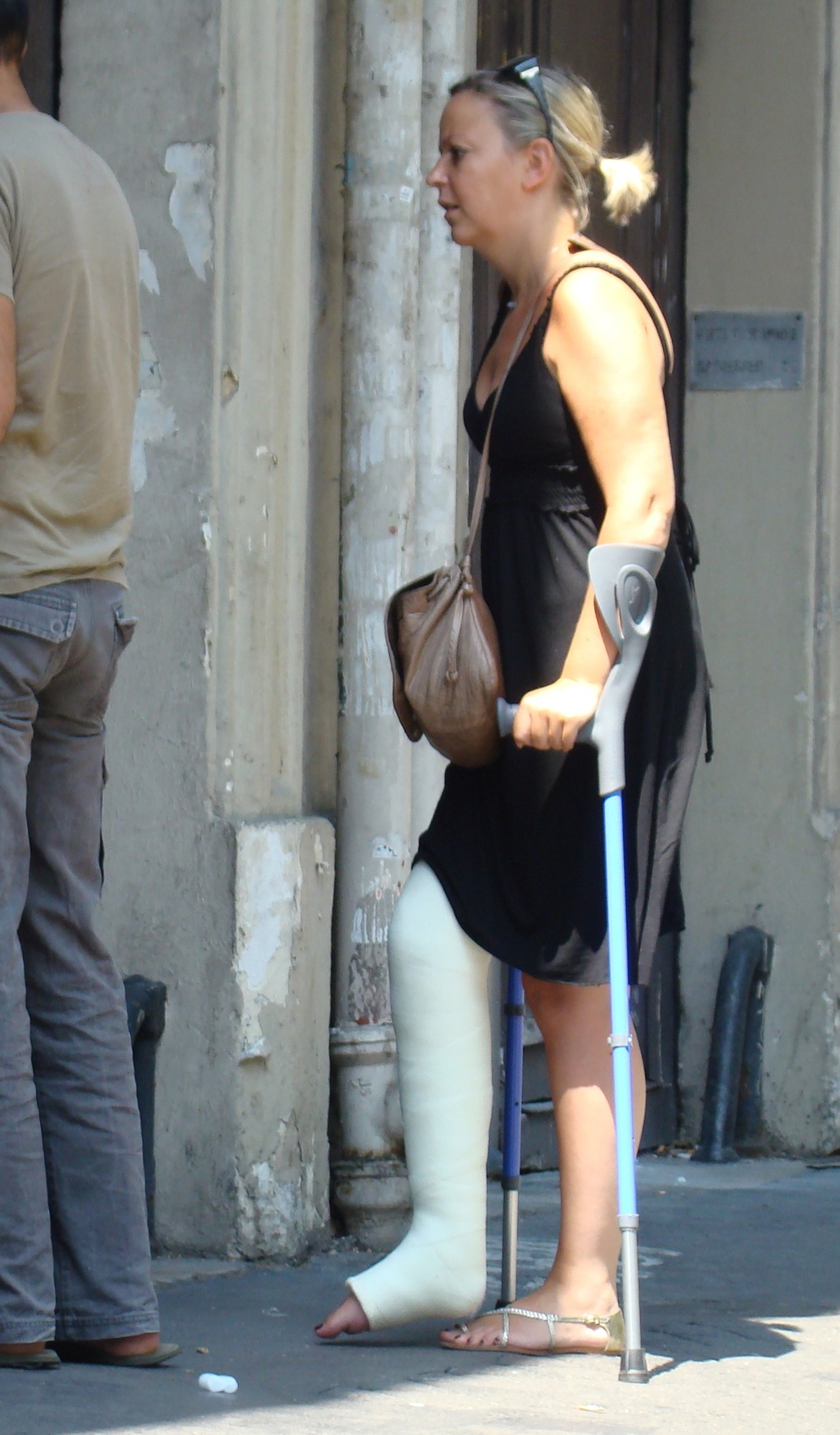 Elderly woman in a long leg cast with crutches... (Pix & Video)