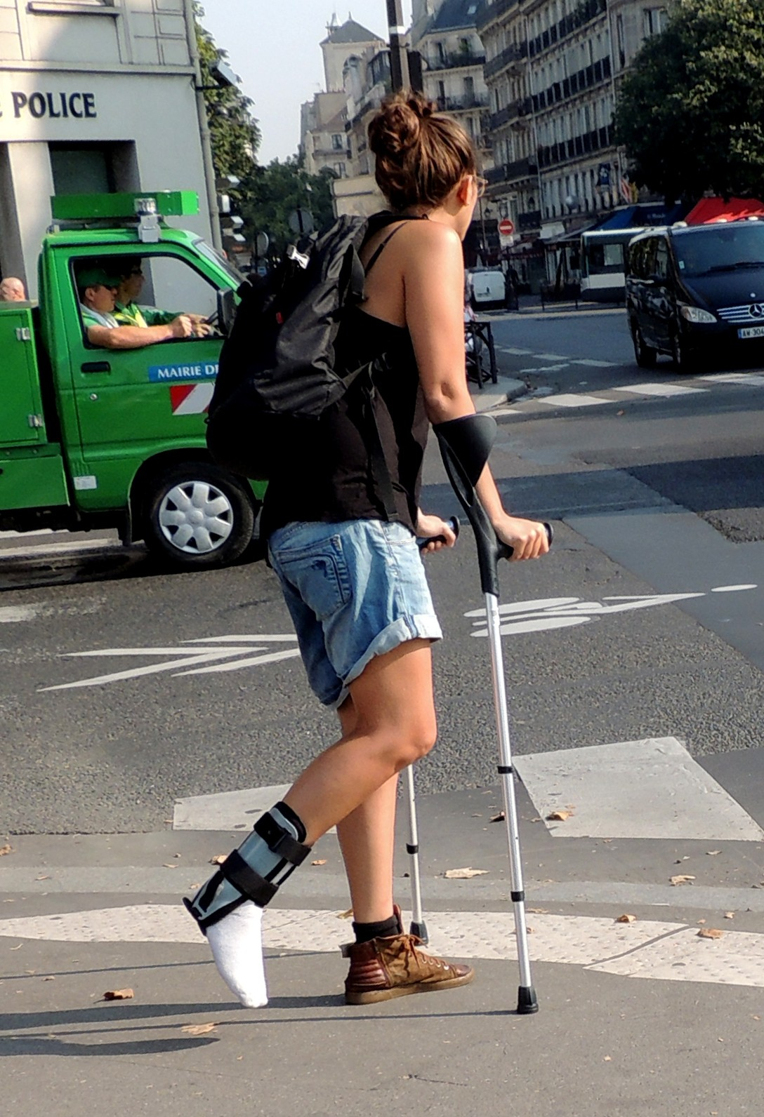 Girl in ankle brace on crutches