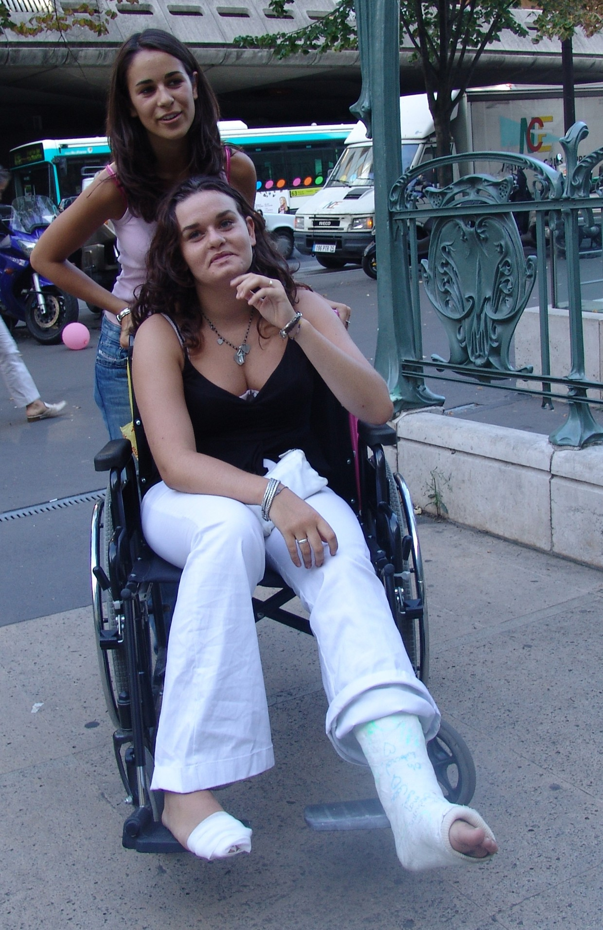 Woman with bandage & cast in wheelchair