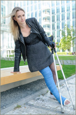 Nastya in blue fibre long leg cast on crutches (50 images in set)