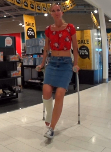 Stefanie SLC #7 -   Stefanie is today crutching in to a Mall. She still has her white term SLC on and we follow her when she crutch in to a store there she first look at some furniture but then sits down and tries on morning slippers which she...