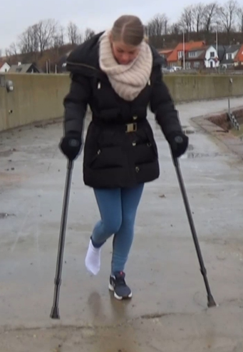 Ice socked sprain & crutches 1612-2  -   Ice jumps out from the car and take her crutches from the trunk. She crutch down to the harbor and out on the pier. Ice right foot is sprain but that dont stop her since she's crutching around without any...