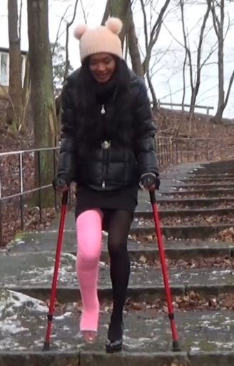 Bunny pink LLC #2-2 - Bunny´s outfit for the day is completely black with plaid, but a pink LLC on her right leg and red crutches still makes her feel colorful. She comes up a long, uncomfortable staircase to crutch down for so Bunny takes a break.