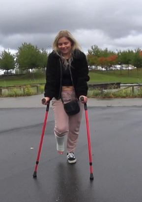 Nathalia SLC - Nathalia crutching in the rain with her white short leg cast (Video: 9 min. - $5)