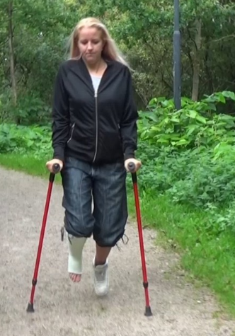 Alva SLC - Alva crutching with her white SLC and red crutches on a short walk in the woods. (Video 15 min - $5)