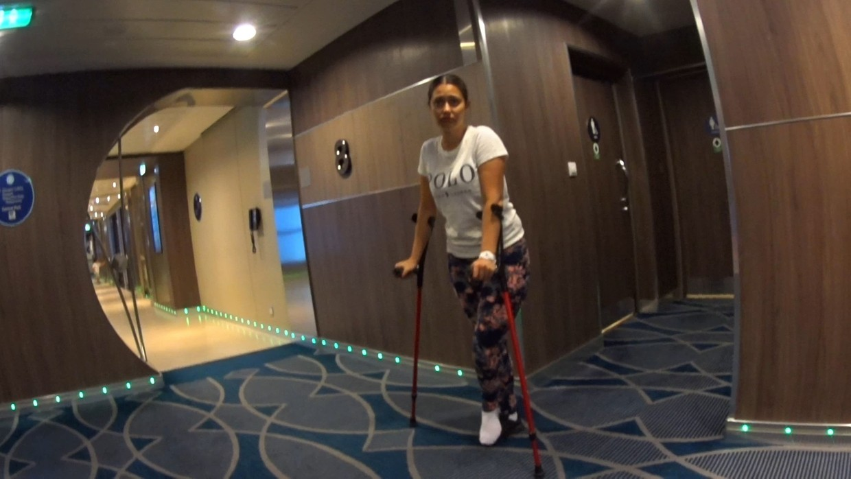 Elisabeth is crutching around on a cruise ship with her sprained ankle in a sock...