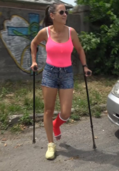Bree SLC - With a pink tank top, short shorts, hair up in a tail, sunglasses and an SLC on her left leg, Bree is out for a little walk with the help of her crutches. + 5 more clips
