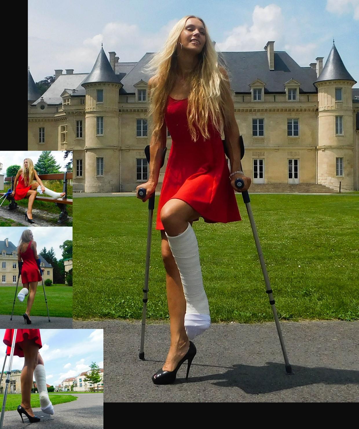 Castlinda SLC - Jolie Modling - Linda in a red dress, high heels and a plaster cast on her leg on crutches...