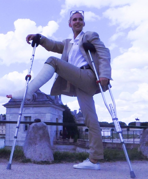 CastLinda in a white SLC #86 - dressed in a business outfit on crutches